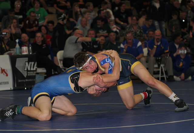 Photo courtesy Rich Viera Boulder City High School senior Jimmy Brown came in second place wrestling in the 132-pound division, losing to Virgin Valley's two-time defending state champion Jacob  ...