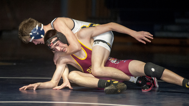 Steve Andrascik/Boulder City Review Boulder City High School wrestler freshman Ladd Cox applies a head lock to his opponent during the 138-pound contest in the tournament against Del Sol on Tuesda ...