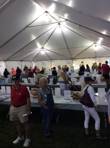 File photo Hundreds of items will be showcased in silent auction, as seen in this photo from a previous year, during the Boulder City Sunrise Rotary Club's 20th annual Wurstfest on Saturday in B ...