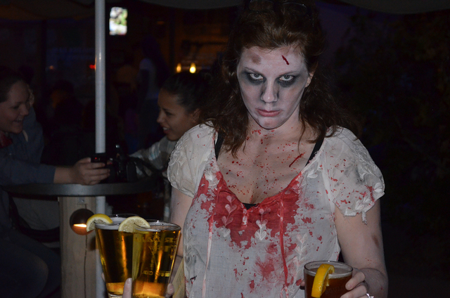 File photo Jennifer Rodriguez gets into the spirit of a recent Zombie Walk in downtown Boulder City. This year's walk, hosted by the Boulder Dam Brewing Co. and the Las Vegas chapter of the Zomb ...