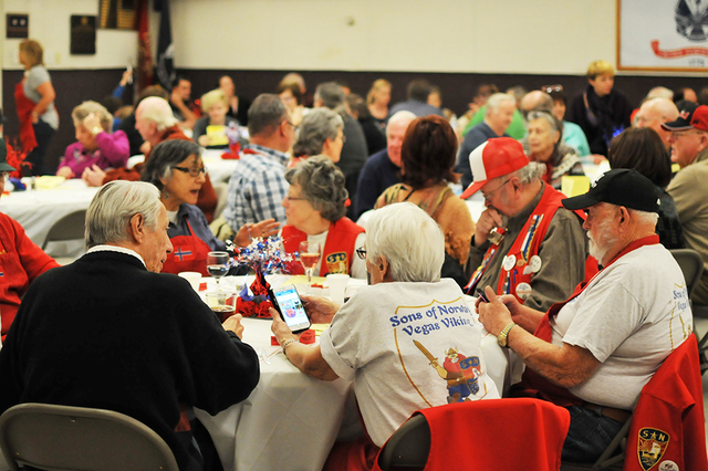 Brian Sandford/View An attendee's Sons of Norway Vegas Viking T-shirt is seen in the foreground during the early lutefisk dinner Jan. 28 at Boulder City Elks Lodge.
