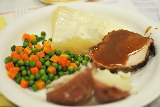 Brian Sandford/View Lutefisk, at the rear of the plate, was served with roasted pork, boiled potatoes and peas and carrots during the Vegas Viking's lutefisk dinner Saturday at Boulder City Elks L ...