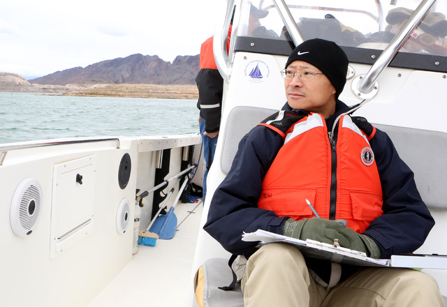 Bizuayehu Tesfaye/Las Vegas Review-Journal @bizutesfaye Sam Luke, a volunteer recorder, scans the skies over Lake Mead in search of eagles on Jan. 12. A group of biologists and volunteers particip ...