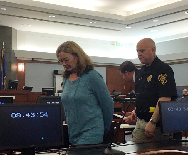 File photo Former Boulder City Animal Control Shelter Supervisor Mary Jo Frazier is seen being taken into custody after appearing in Clark County District Court on March 8, 2016, in Las Vegas. Fra ...