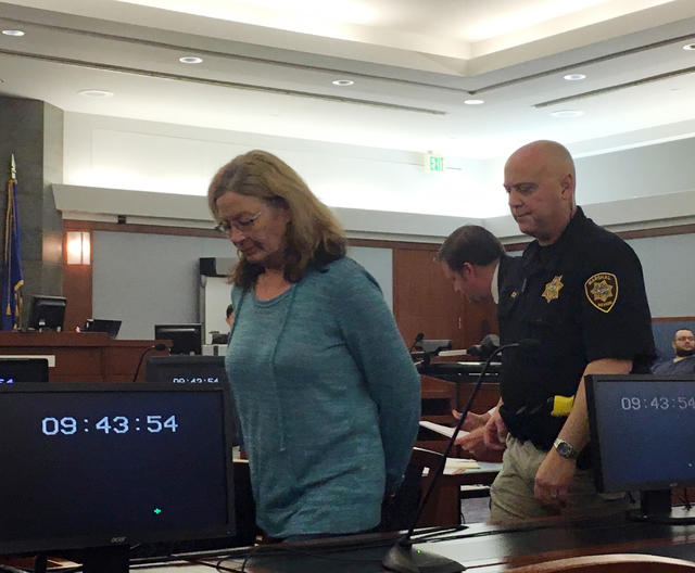 File photo Former Boulder City Animal Control Shelter Supervisor Mary Jo Frazier is seen being taken into custody after appearing in Clark County District Court on March 8 in Las Vegas. Frazier pl ...