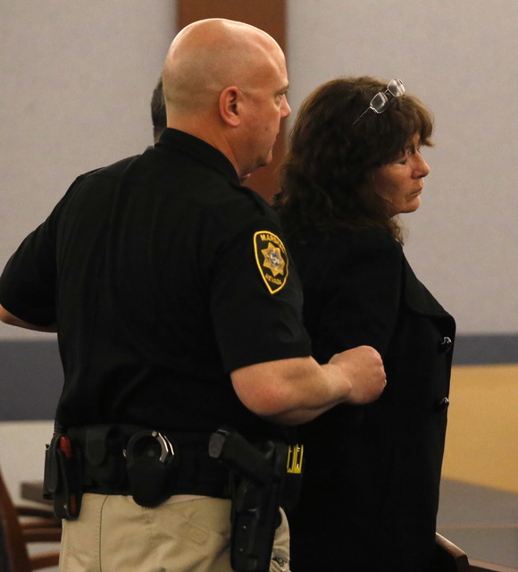 Christian K. Lee/Las Vegas Review-Journal Mary Jo Frazier, the former head of the Boulder City animal shelter, is placed in handcuffs after receiving her sentence Tuesday in Las Vegas. Frazier was ...