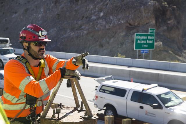Erik Verduzco/Las Vegas Review-Journal Ryan Nataluk, bridge and structure inspection manager with Stantec, speaks on the inspection progress of the Mike O'Callaghan-Pat Tillman Memorial Bridge at  ...