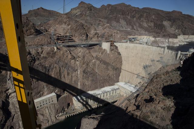Erik Verduzco/Las Vegas Review-Journal Hoover Dam provides a staggering backdrop from the Mike O'Callaghan-Pat Tillman Memorial Bridge as crews work to inspect for deficiencies Jan. 31.