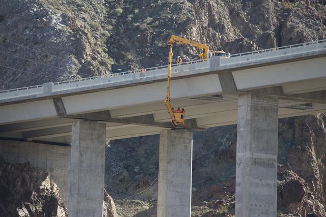 Erik Verduzco/Las Vegas Review-Journal Crews inspect the Mike O'Callaghan-Pat Tillman Memorial Bridge for deficiencies at the Hoover Dam on Jan. 31.