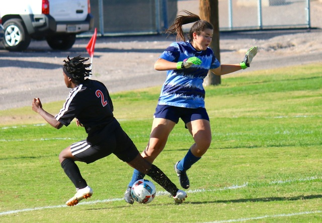 In a successful attempt to block the shot, Goalkeeper Erin Taggard charged the ball and the Chaparral player running the ball. Each player had a solid kick that sent both girls to the ground and t ...