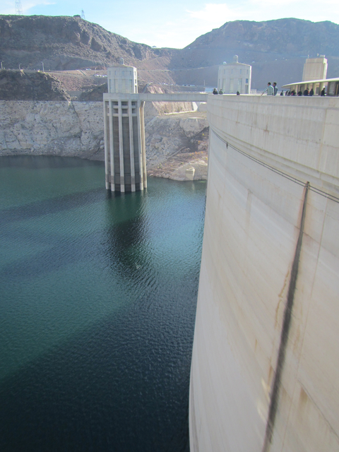 Las Vegas Review-Journal file photo Tourists walk along the top of Hoover Dam earlier this month. The Bureau of Land Management awarded the Bureau of Reclamation $2.7 to improve the dam's visitors ...