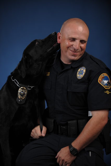 Courtesy photo Boulder City Police Department K-9 officer Charlie, seen here with his partner and handler officer Alan Nutzman, had to be euthanized Saturday after having his medical conditioned w ...