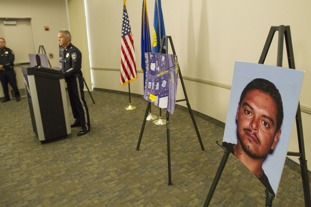A photo of Javier Munoz, 28, is shown during a news conference at the Nevada Highway Patrol Southern Command Headquarters in Las Vegas on Oct. 25. Munoz was shot Oct. 19, and died the next day. Mu ...