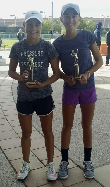 Courtesy photo Olivia Mikkelson, 14, left, of Boulder City, and her partner Bitsy Tullis, 14, of Centerville, Utah, show off their trophies after placing second in USTA Open Regional Doubles Tourn ...
