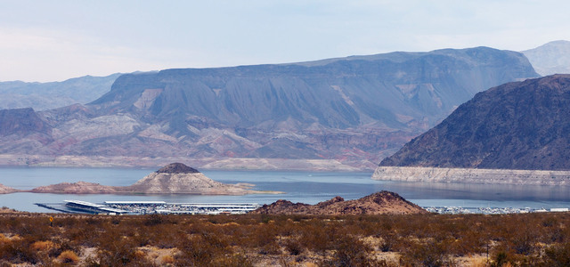 """The """"bathtub ring"""" can be seen at the Boulder Basin Las Vegas Boat Harbor at Lake Mead on Aug. 4. The lake's level fell to 1,071.61 feet above sea level on July 1, its lowest since May 1937 when t ..."""