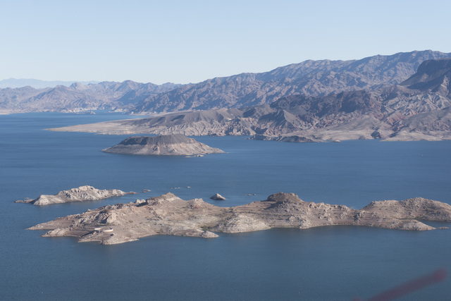 Jason Ogulnik/Las Vegas Review-Journal The bathtub ring at Lake Mead National Recreation Area shows how much the water level has dropped. It currently sits at about 1,087 feet, near historic low l ...