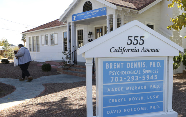 """Bizuayehu Tesfaye/Las Vegas Review-Journal Police served a search warrant at the Boulder City Mental Health Clinic of Susan Winters' husband, Gregory """"Brent"""" Dennis, at 555 California Ave. on  ..."""