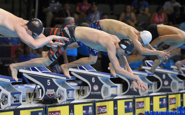 Zane Grothe, center, dives at the start of a preliminary heat in the Men's 400-meter freestyle at the U.S. Olympic swimming trials Sunday in Omaha, Nebraska. Mark J. Terrill/The Associated Press