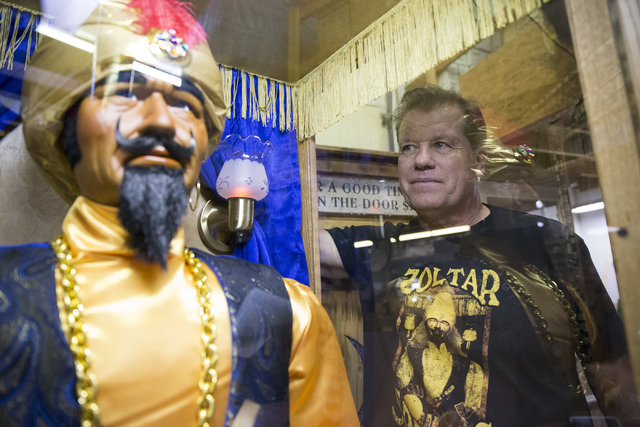 Erik Verduzco/Las Vegas Review-Journal Olaf Stanton, owner of Characters Unlimited, next to a Zoltar fortune teller machine at his company's workshop recently in Boulder City.