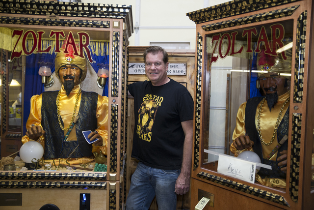 Erik Verduzco/Las Vegas Review-Journal Olaf Stanton, owner of Characters Unlimited, stands next to a Zoltar fortune teller machine at his company's workshop recently in Boulder City.