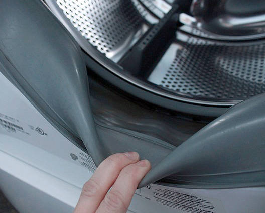 Norma Vally Wipe the folds of the seals of your washing machine with a water-bleach solution to help keep odors at bay.