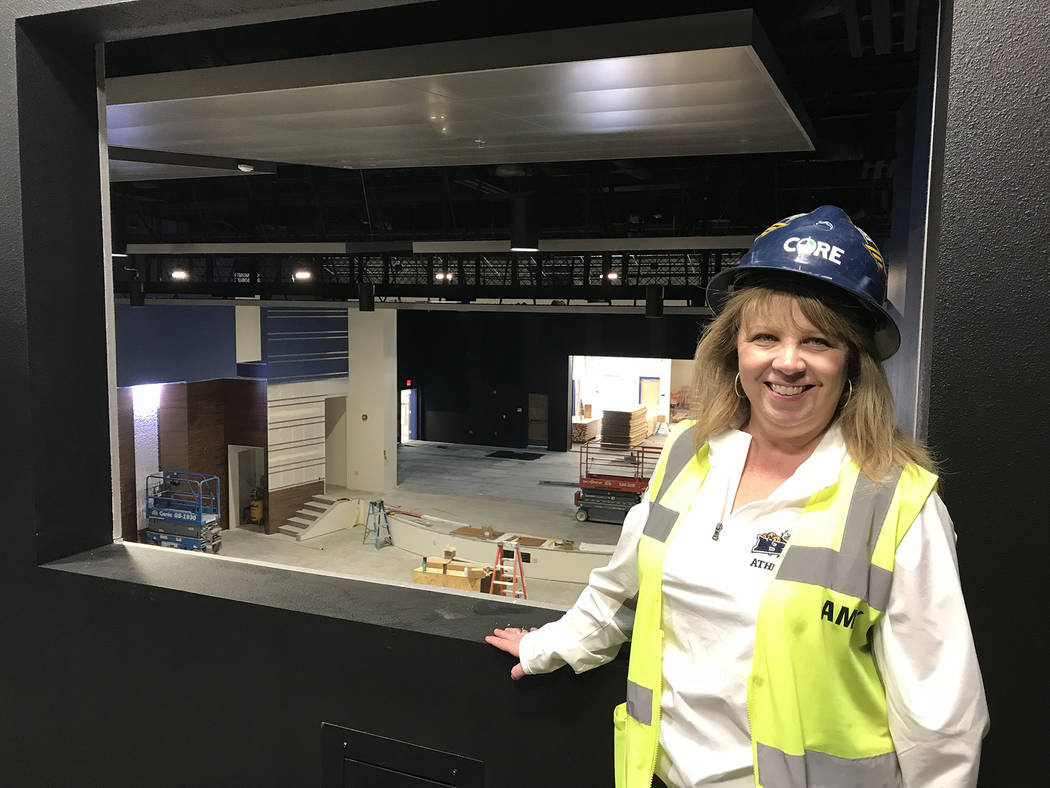 Hali Bernstein Saylor/Boulder City Review Boulder City High School Principal Amy Wagner visited the new theater as construction crews worked Feb. 2 to complete the project. It will include a state ...