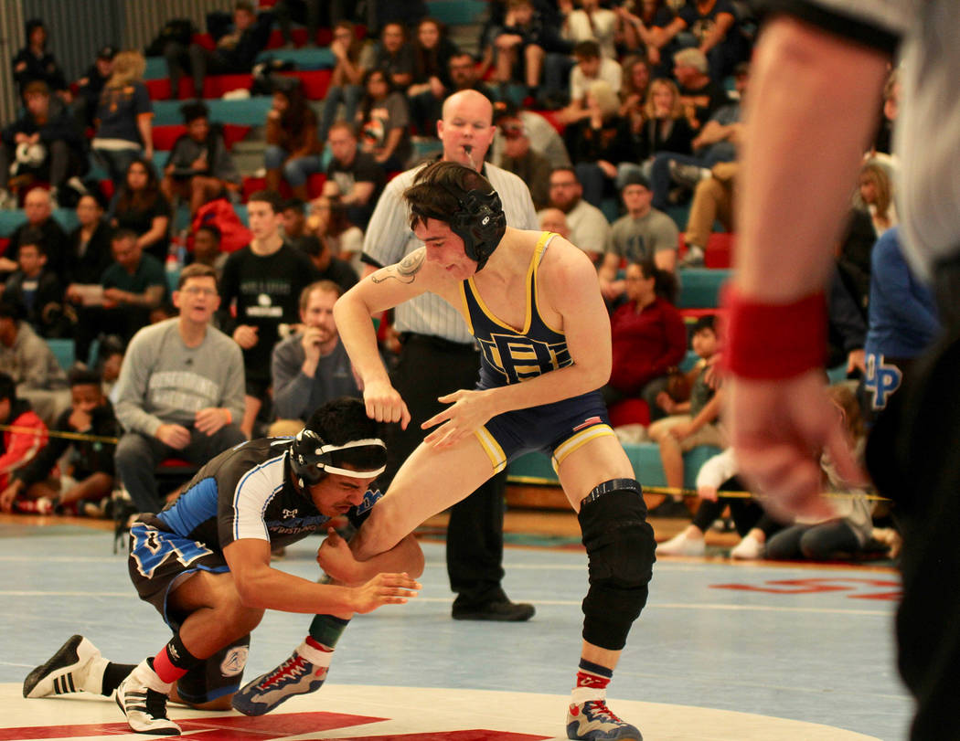 Rich Viera Boulder City High School senior Zayne Dennington won the 126-pound individual regional title at Western High School on Saturday coming from behind and competing with a torn ACL.