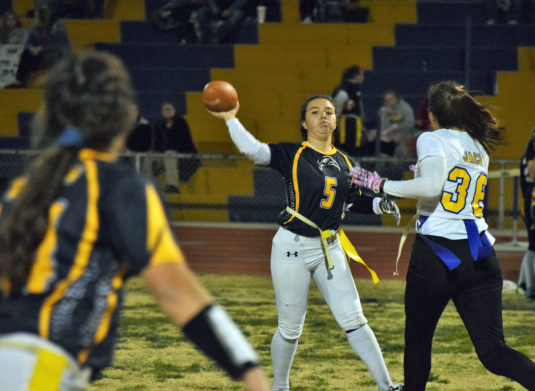 Robert Vendettoli/Boulder City Review Boulder City High School sophomore quarterback Makaela Perkins connects with junior Ryann Reese for a 19-yard gain in the third quarter against Moapa Valley o ...
