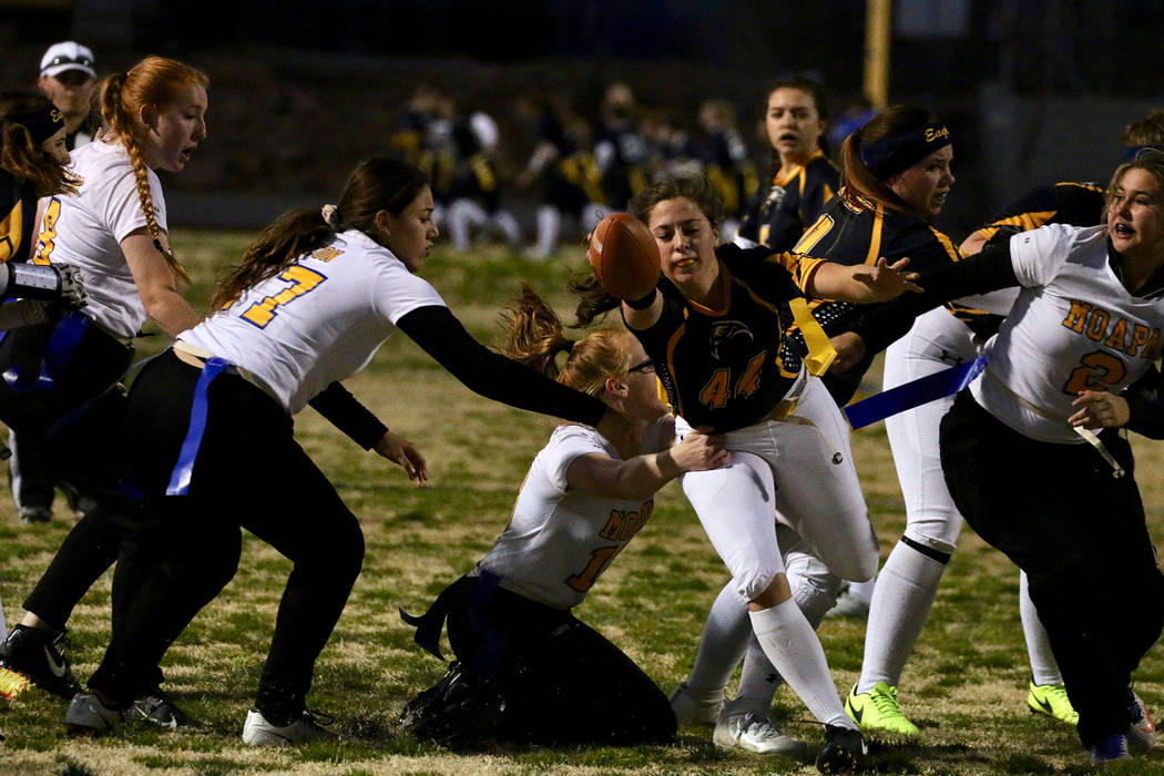"""Nichole Del Rio/Boulder City Review""""Boulder City High School senior Nickki Meleo runs the ball to score a touchdown in the Lady Eagles' game against Moapa Valley High School on Tuesday. The Lady  ..."""