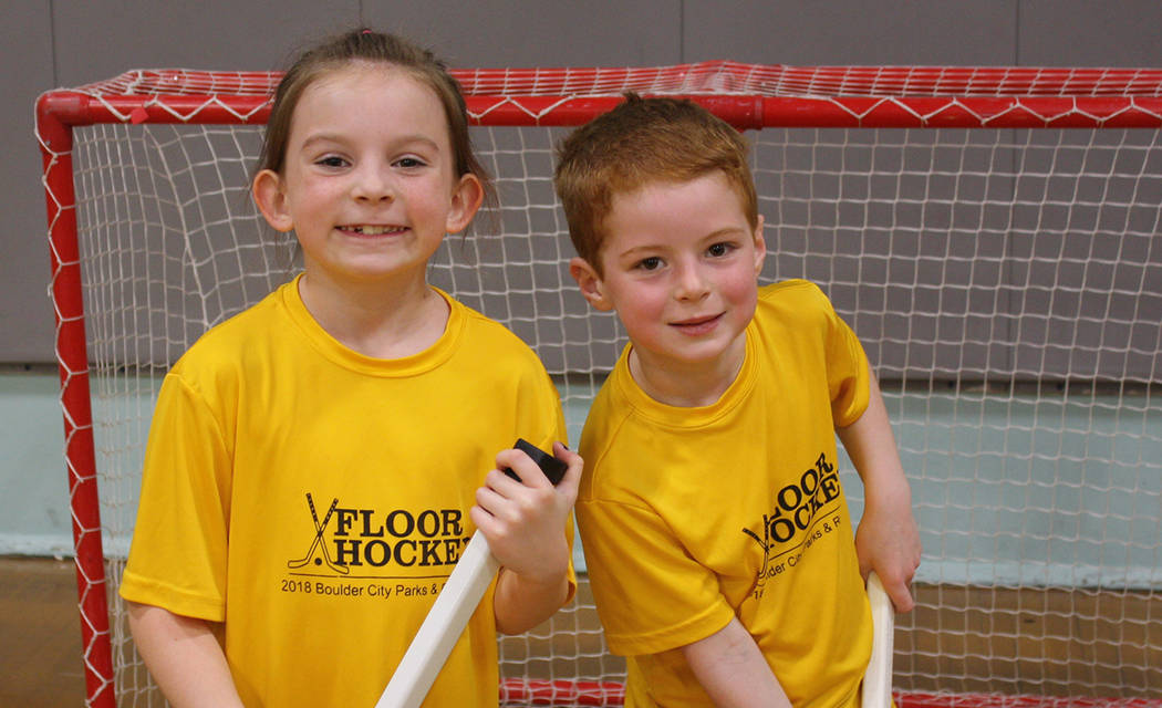 Boulder City Parks and Recreation Emerson Prestwich and Cameron Hallam, who play with The Golden Knights youth floor hockey team in Boulder City's Park and Recreation's league, prepare for a recen ...