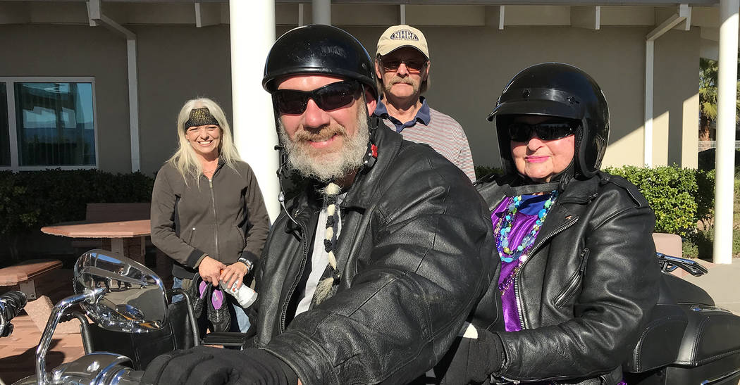 Hali Bernstein Saylor/Boulder City Review Rick Hillis, founder of One Hero at a Time, volunteered to give Virginia Mahaney, a resident of the Nevada State Veterans Home, a ride on his Harley-David ...