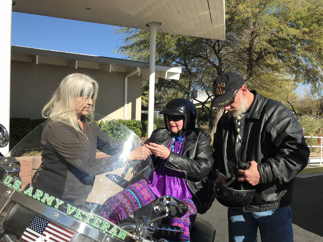 Hali Bernstein Saylor/Boulder City Review Patty Ashworth, left, helps Rick Hillis, founder of One Hero at a Time, properly outfit Virginia Mahaney, a resident of the Nevada State Veterans Home, fo ...