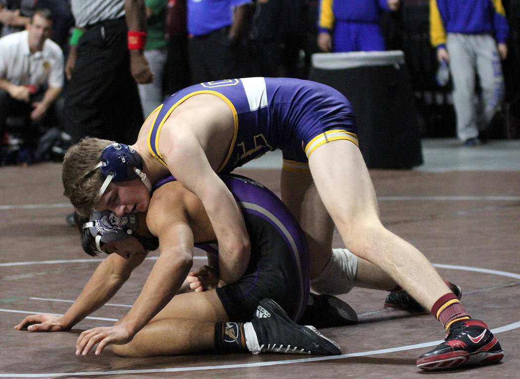 Rich Viera Boulder City High School sophomore Ladd Cox, seen wrestling at the state championships Friday, Feb. 9, 2018, at The Orleans, was eventually pinned by his opponent in the in 145-pound we ...