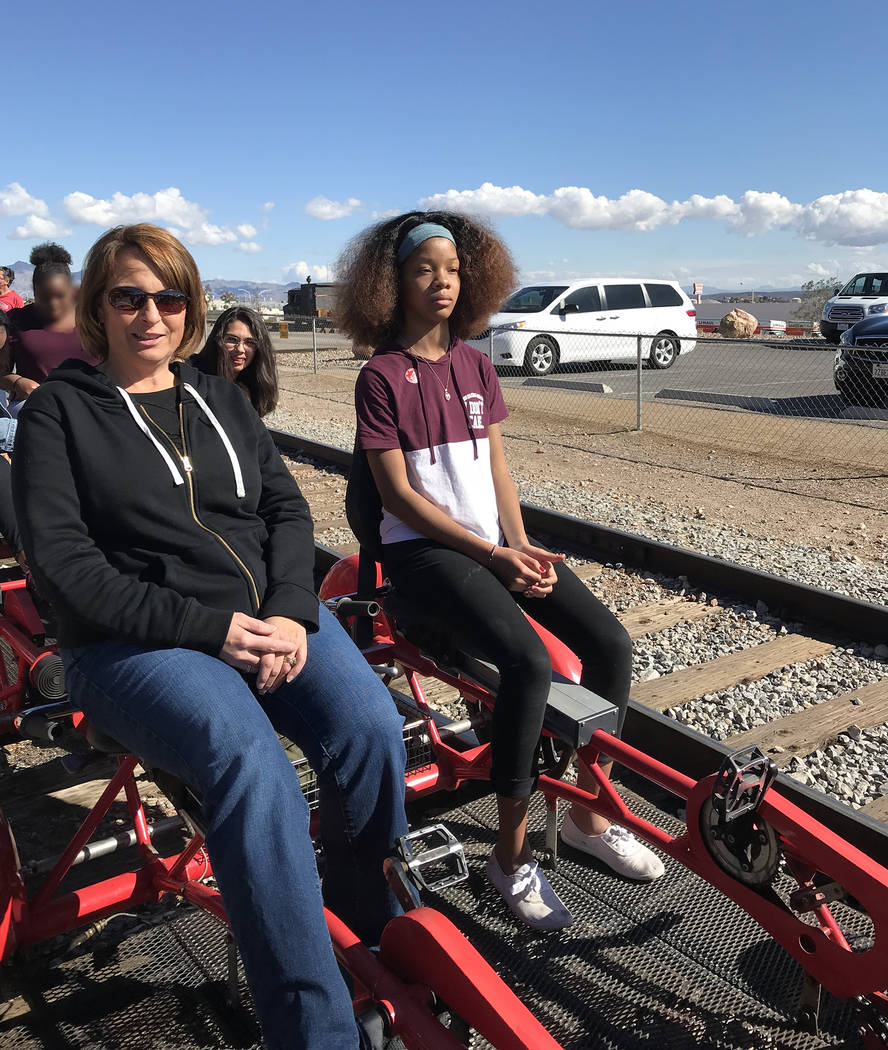 Hali Bernstein Saylor/Boulder City Review St. Jude's Ranch for Children youth care specialist Tina Bellerose, left, and Dallas Tanner, 13, get ready to pedal a rail car as Rail Explorers hosted ar ...