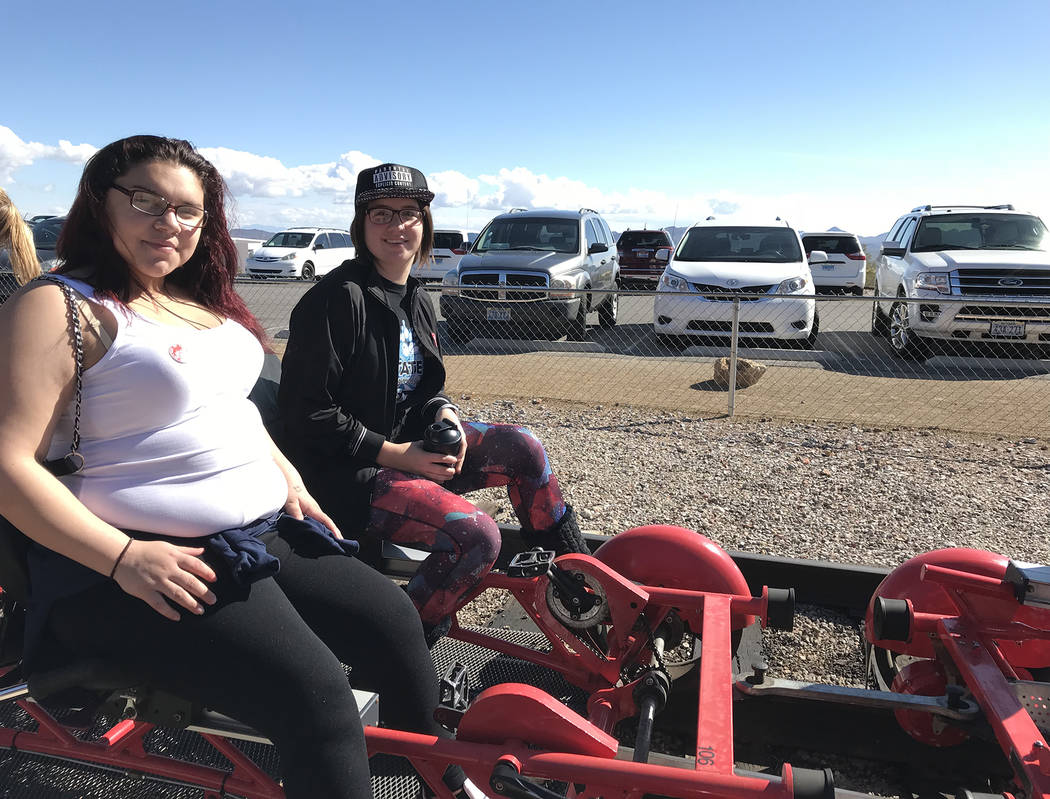 Hali Bernstein Saylor/Boulder City Review Karen Orellana, 16, left, and Sarah Bernstein, 17, get ready to ride the rails Feb. 15 as Rail Explorers hosted about 40 children and staff members from S ...
