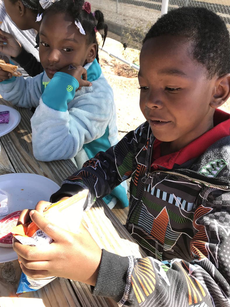 """Hali Bernstein Saylor/Boulder City Review Camille Moore, 7, and her brother Latino """"Junior"""" Moore, 6, enjoy lunch before touring the Nevada State Railroad Museum and going on a rail car adventure  ..."""