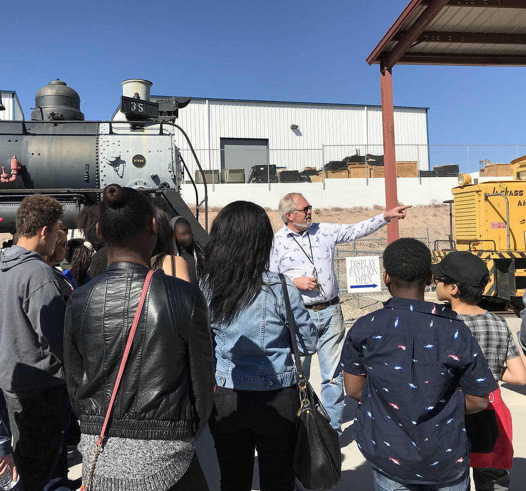 Hali Bernstein Saylor/Boulder City Review Randy Hees, director of the Nevada State Railroad Museum, leads a tour for children from St. Jude's Ranch for Children on Feb. 15. They were guests of Rai ...