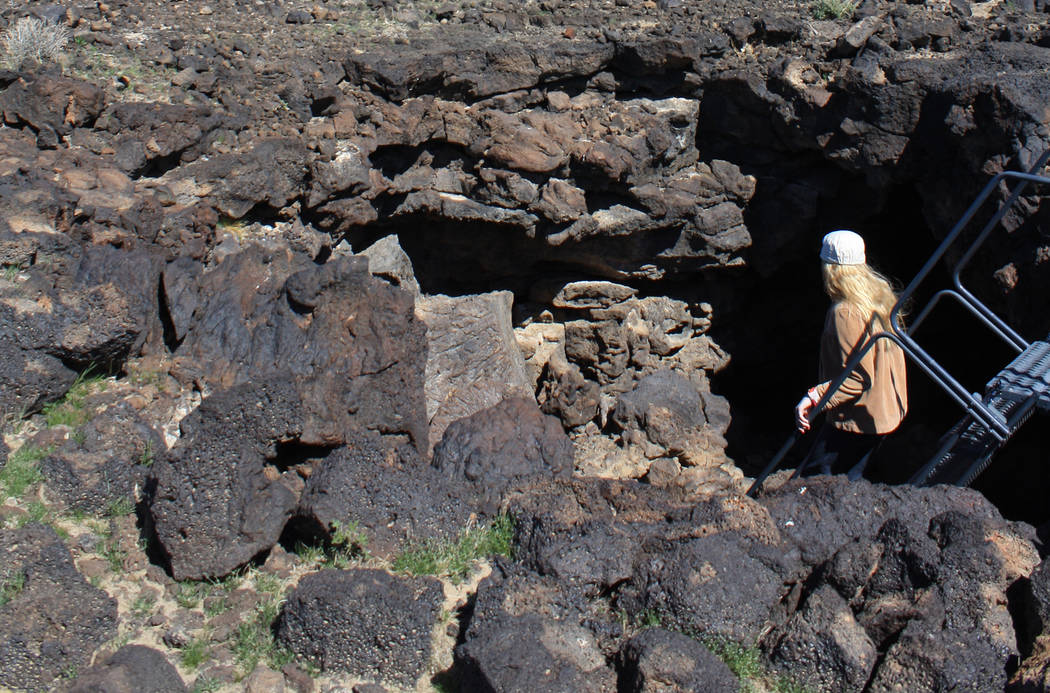 Deborah Wall A hiker takes the stairs down into the lava tube at Mojave National Preserve in California. It is about a two hour drive from Boulder City.