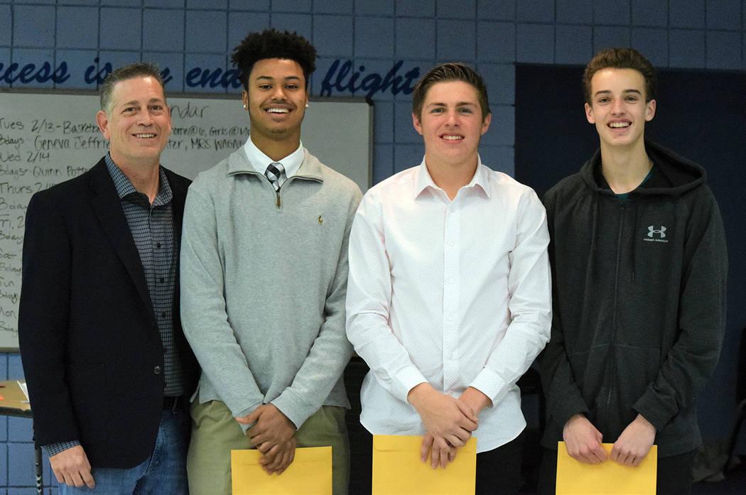 Robert Vendettoli/Boulder City Review Boulder City High School head boys basketball coach John Balistere, left, congratulates his star players, from left, junior Derrick Thomas, senior Carson Bali ...