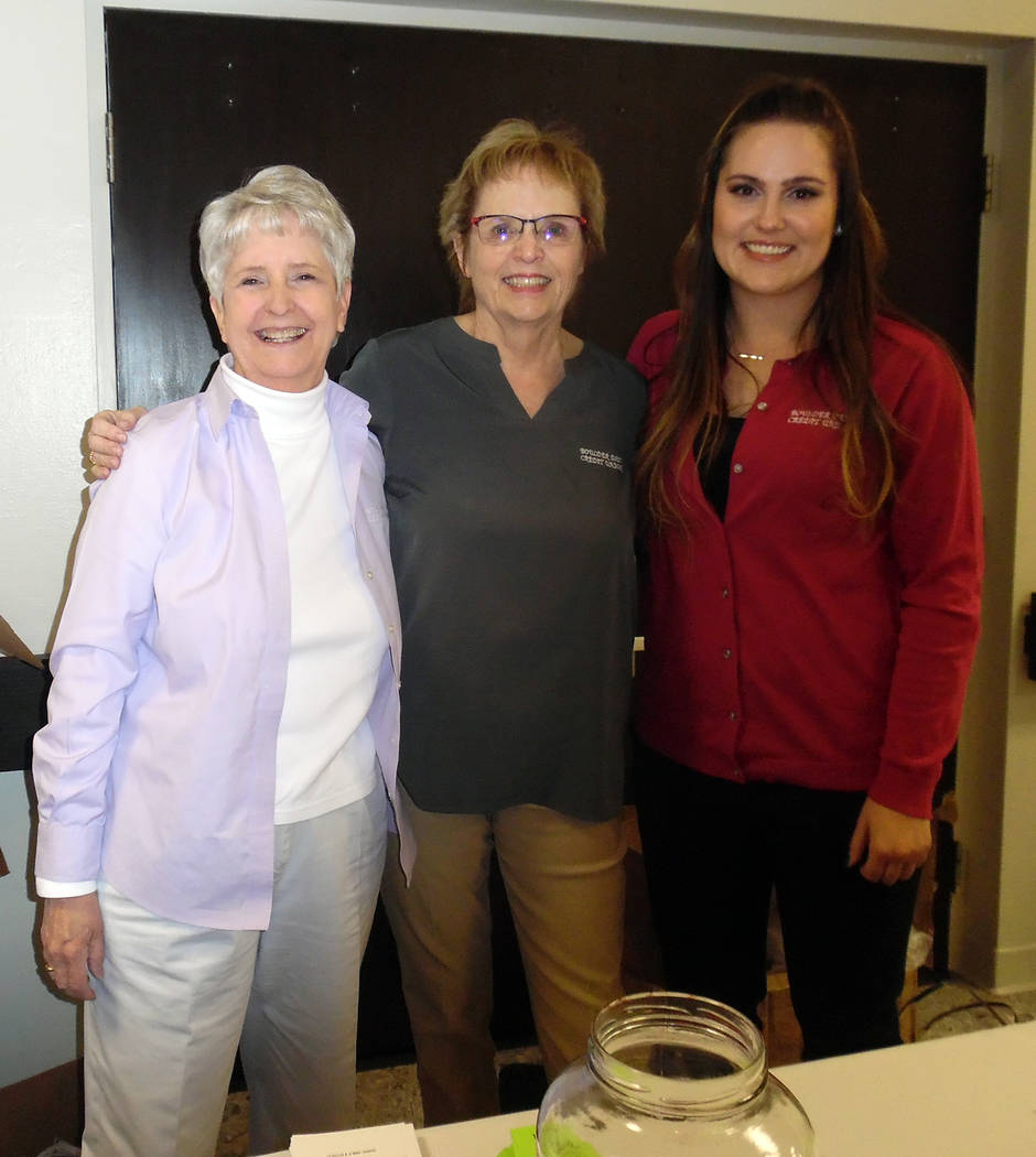 Hali Bernstein Saylor/Boulder City Review Boulder Dam Credit Union employees, from left, Nancy Ward, Mary Beth Clift and Bailey Hagen greeted those attending the financial institution's annual mee ...