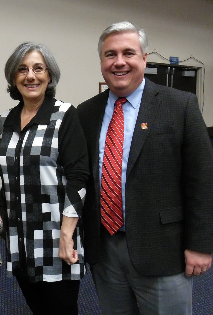 Hali Bernstein Saylor/Boulder City Review Charmaine Ferrari, who was re-elected to Boulder Dam Credit Union's board of directors, visits with Jeff Breeden, a member of the financial institution's  ...