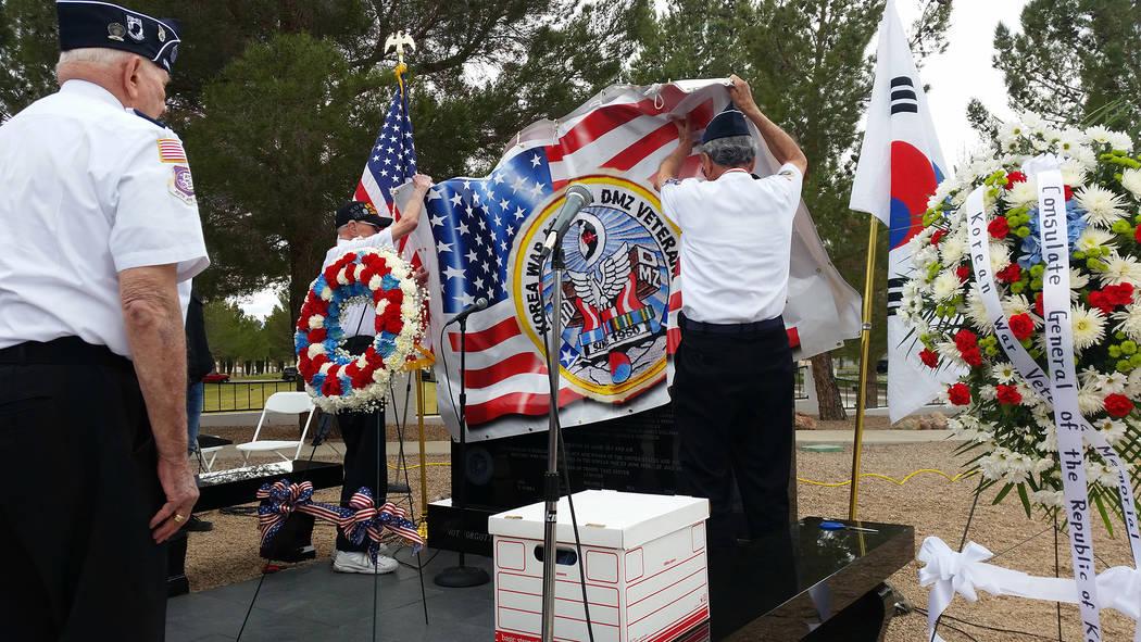 Celia Shortt Goodyear/Boulder City Review Members of the Korean War Veterans Association Tibor Rubin Medal of Honor Chapter No. 329 in Las Vegas unveil the new Korean War memorial in the Memorial  ...