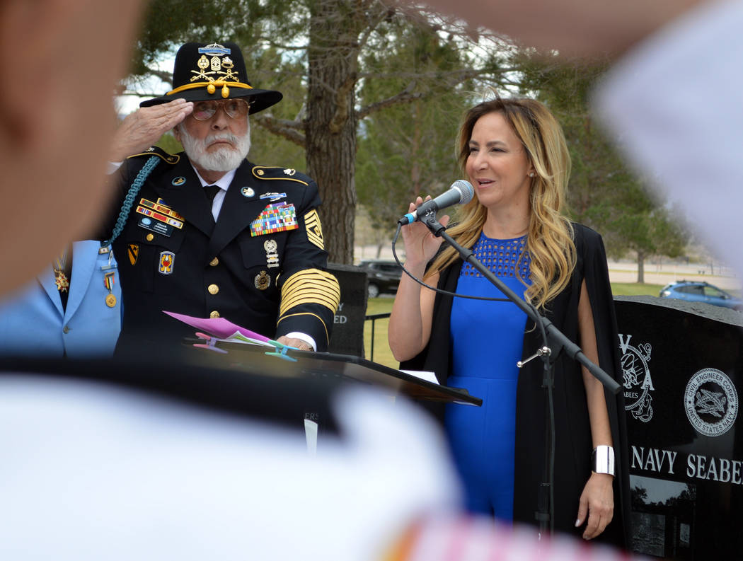Celia Shortt Goodyear/Boulder City Review Christy Molasky sings the national anthem at the dedication ceremony for a Korean War memorial on Saturday at the Southern Nevada Veterans Memorial Cemete ...