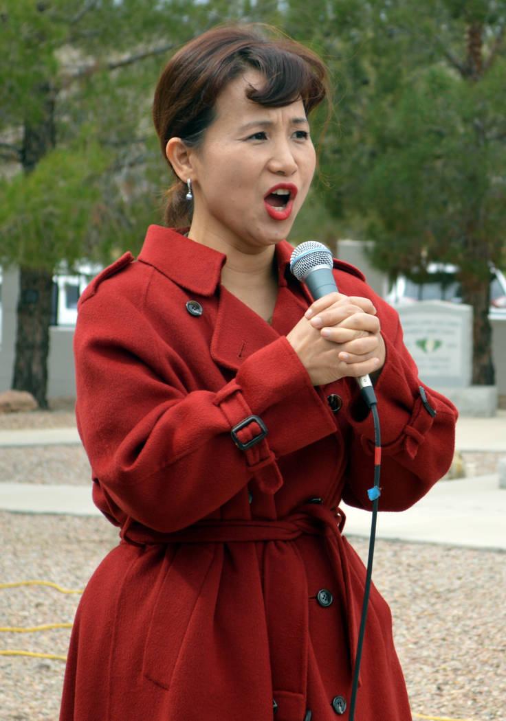 Celia Shortt Goodyear/Boulder City Review Eun Hee Kim sings the Korean national anthem Saturday during the dedication for a new Korean War memorial at the Southern Nevada Veterans Memorial Cemeter ...
