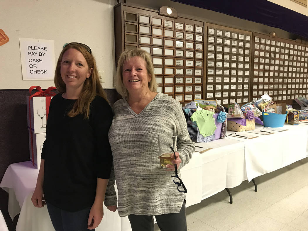 Hali Bernstein Saylor/Boulder City Review Andrea Finnegan, left, and Robby Burnett look at the silent auction items at Saturday's, March 3, 2018, Mexican Chip Dip Competition presented by the Boul ...