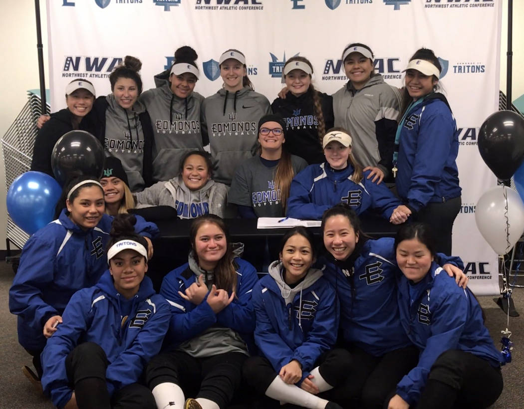 Lily Osman Boulder City High School softball standout Lily Osman, center, is surrounded by members of the Tritons softball team after she signed her letter of intent to play for Edmonds Community  ...