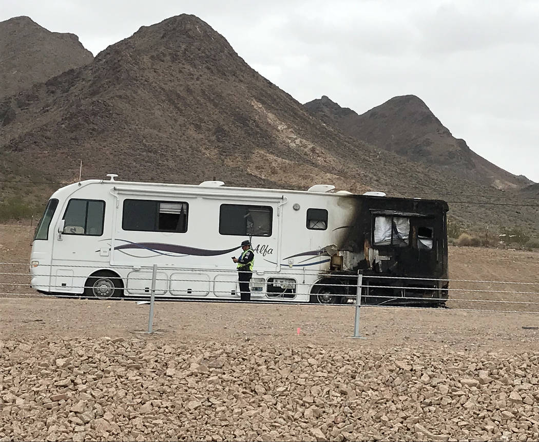 Hali Bernstein Saylor/Boulder City Review A member of law enforcement checks out a motor home on U.S. Highway 93/U.S. Highway 95 after it caught on fire Saturday morning. The incident caused hours ...