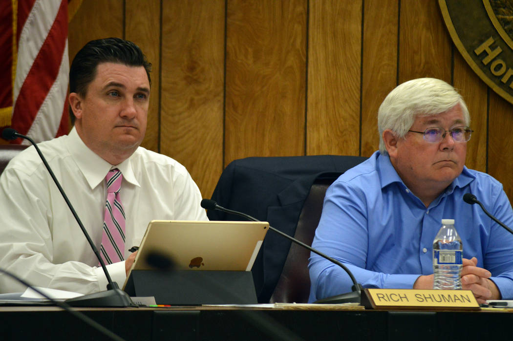 Celia Shortt Goodyear/Boulder City Review Councilman Rich Shuman, left, and Councilman Kiernan McManus listen to a presentation at the City Council meeting on Tuesday about moving the election cyc ...