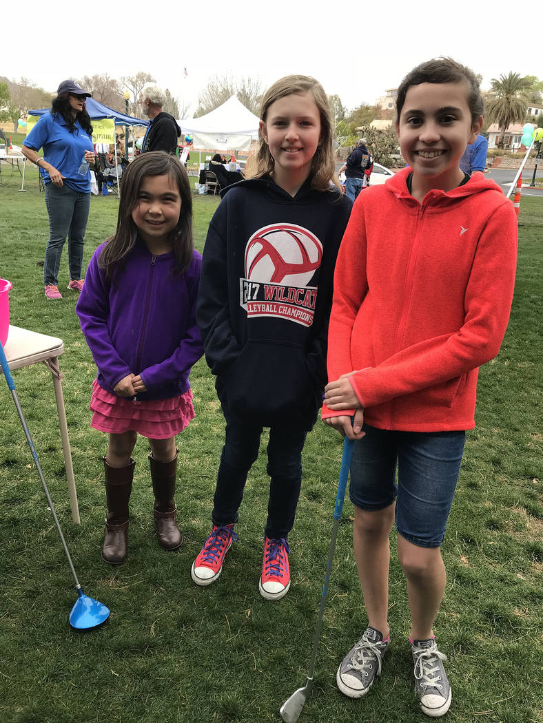 Hali Bernstein Saylor/Boulder City Review A kids zone was added to the festivities at the Rock, Roll & Stroll, held Saturday to raise funds for the Senior Center of Boulder City. Sisters, from lef ...