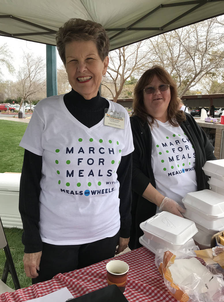 Hali Bernstein Saylor/Boulder City Review Joyce Lewis, left, vice president of the Senior Center of Boulder City's board of directors, helps Melinda Reddin, kitchen manager at the center, sell lun ...